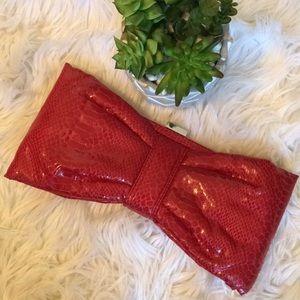Red python print bow clutch